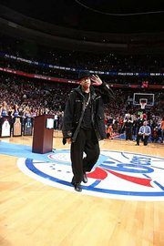 Allen Iverson cups his hand and asked to hear his favorite tune during his jersey retirement ceremony on March 1.-Photo by Philadelphia Sixers.