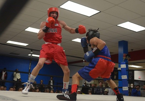 Jalonte Cole (left) of the NoXcuse Gym tries to land a punch against Tommy Avelar of the Sugar Ray Leonard Gym during the third week of the 2014 Washington Golden Gloves Championship Tournament on Saturday, March 8, at the Sugar Ray Leonard Boxing Center in Hyattsville, Md.