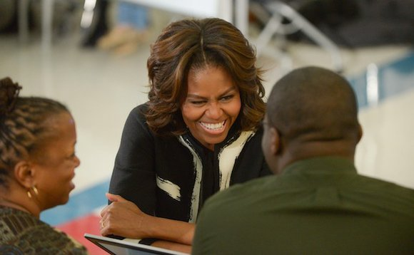 First lady Michelle Obama joined Tuesday the push to get the uninsured signed up for health care coverage as the ...