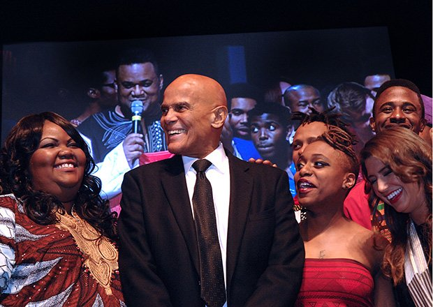 Harry Belafonte, center, surrounded by students from the Berklee College of Music at a concert in his honor on March 6. The students sang a retrospective of songs from Belafonte's musical career.