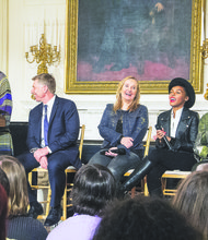"First lady Michele Obama greets students who attended a workshop titled ""I'm Every Woman: The History of Women in Soul"" in the White House State Dining Room on March 6. Grammy Museum Executive Director Robert Santelli (seated, at left) moderated a discussion with artists (from left) Melissa Etheridge, Janelle Monae and Patti LaBelle."