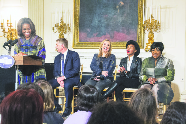 """First lady Michele Obama greets students who attended a workshop titled """"I'm Every Woman: The History of Women in Soul"""" in the White House State Dining Room on March 6. Grammy Museum Executive Director Robert Santelli (seated, at left) moderated a discussion with artists (from left) Melissa Etheridge, Janelle Monae and Patti LaBelle."""