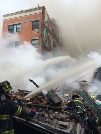 NEW YORK (CNN) -- At least two people were killed after a massive explosion and raging fire Wednesday morning in ...