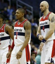 From left: John Wall, Bradley Beal and Marcin Gortat (Courtesy of XNSPORTS)