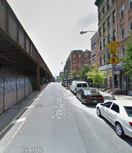 Google Map of the Metro North tracks on the left and two buildings which exploded and collapsed on the right.