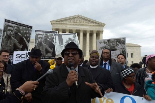 Southern Christian Leadership Conference President Charles Steele Jr. (center) speaks at the base of the U.S. Supreme Court building in D.C. during a rally for voting rights on Wednesday, March 12.