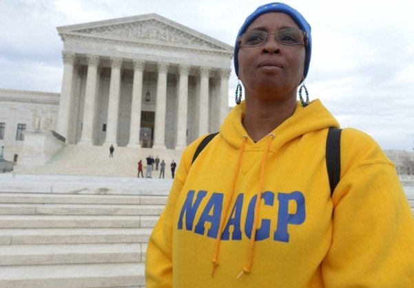 Tisda Campbell of Athens, Ala., stands in front of the U.S. Supreme Court building in D.C. on Wednesday, March 12 during a rally for voting rights.