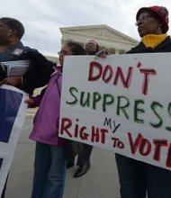 Demonstrators converge at the base of the U.S. Supreme Court building in D.C. during a rally for voting rights Wednesday, March 12.