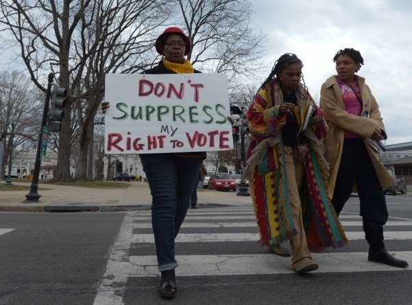 Demonstrators make their way from Union Station to the U.S. Supreme Court building in D.C. during a rally for voting rights Wednesday, March 12.