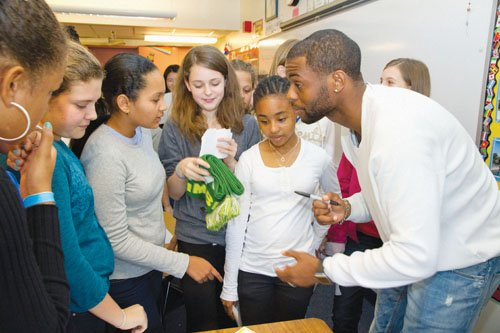 Timbers player Frédéric Piquionne, a native of Martinique, signs autographs during a cultural exchange at the Oregon Episcopal School with students from the school and visiting students from Martinique.