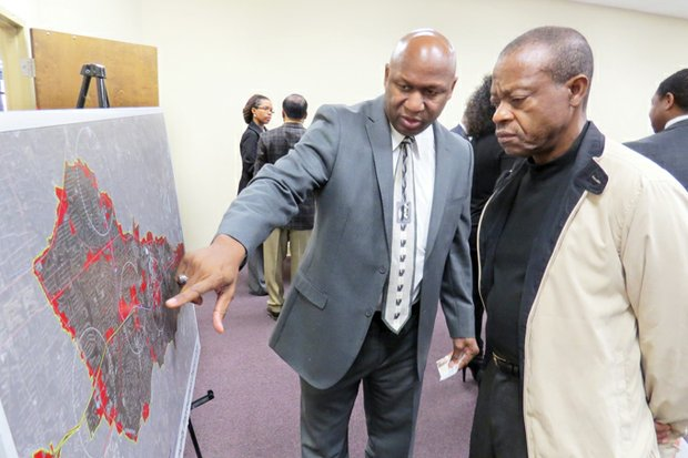 Ernest Gilchrist and Cornelius Jackson, who owns property on South Rainbow Drive, look over the boundaries of the proposed East Metro DeKalb CID.