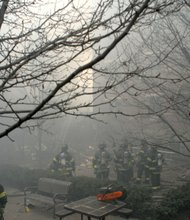 More than 200 firefighters worked on the two collapsed buildings in East Harlem on March 12
