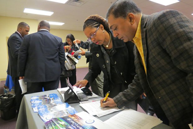 Mack Patel, president of the Super Inn Motel on Wesley Chapel Road, signs up to join the proposed East Metro DeKalb CID.