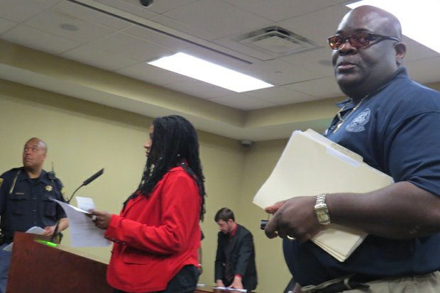 Jackie McHugh, (in red) successfully challenged one of the code citations  against her in DeKalb Recorders Court. Code Compliance Officer A. Baptiste is at right.