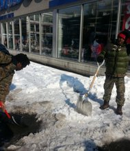 PSP members shoveling snow in Harlem in February