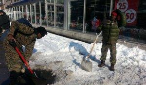 PSP members shoveling snow in Harlem in February