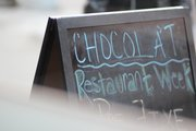 Photo of a sign outside of Chocolat, Harlem by Bryant Buernet
