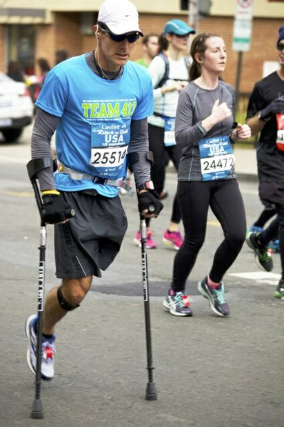 Larry Chloupek of Herndon, Va., participates in the D.C. Rock 'n' Roll Marathon in Northwest on March 15, 2014. Chloupek represented Team 413, a faith-based organization that inspires people through running.