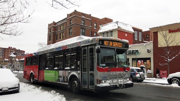 An off-duty Metro bus drives through the District on March 17, 2014, after a winter storm hit the region.