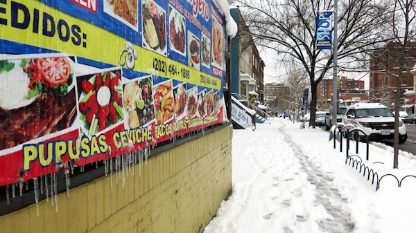 Icicles form on a restaurant banner on Columbia Road in Northwest D.C. on March 17, 2014, after a winter storm hit the region.