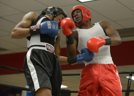 Teaquone Nance (Nomis Gym) trades blows with Justin Bell (NoExcuse) during a semifinals bout in the 2014 Washington Golden Gloves championship tournament at the Sugar Ray Leonard Boxing Center in Palmer Park, Md., on March 15. Bell won the match to advance to the finals.