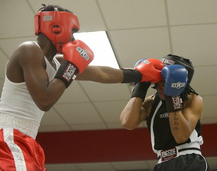 Justin Bell (NoExcuse) lands a jab against Teaquone Nance (Nomis Gym) in a semifinals bout in the 2014 Washington Golden Gloves championship tournament at the Sugar Ray Leonard Boxing Center in Palmer Park, Md., on March 15. Bell won the match to advance to the finals.
