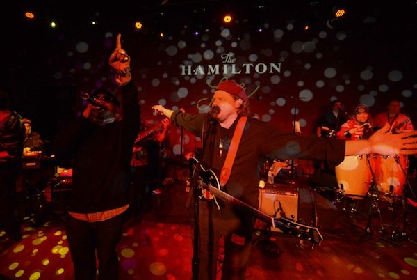 Hip-hop artist Head-Roc (left) performs with D.C.-based afrofunk band Chopteeth at the Hamilton in Northwest on Friday, March 14.