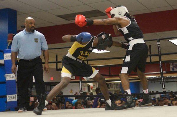 Montell Pridgett (Umar) lands a body blow against Jonathan Ludson (Monsters, Inc.) during a semifinals bout in the 2014 Washington Golden Gloves championship tournament at the Sugar Ray Leonard Boxing Center in Palmer Park, Md., on March 15. Pridgett defeated Ludson and will face Gary Antuanne Russell on March 29 in Waldorf, Md., for the championship.