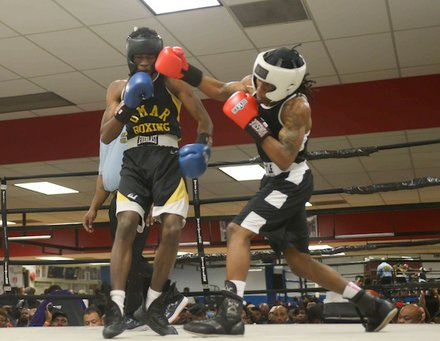Jonathan Ludson (Monsters, Inc.) lands a solid right hook against Montell Pridgett (Umar) during a semifinals bout in the 2014 Washington Golden Gloves championship tournament at the Sugar Ray Leonard Boxing Center in Palmer Park, Md., on March 15. Pridgett won to advance to the finals.