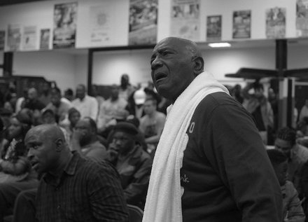 "Legendary boxing coach Abraham ""Ham"" Johnson watches his fighter Christopher Perkins (Woodland Gym) during a semifinals bout in the 2014 Washington Golden Gloves championship tournament at the Sugar Ray Leonard Boxing Center in Palmer Park, Md., on March 15. Perkins lost to Shynggskhan Tazhibay (Raw Assassin Gym)."