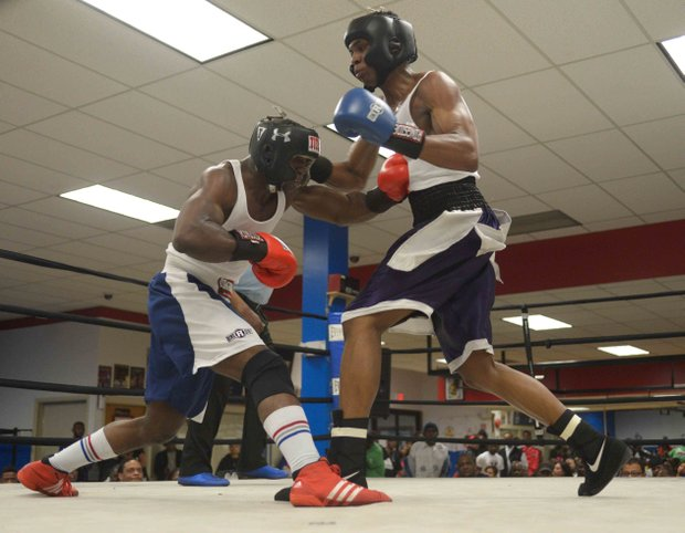 Jerome Featherstone (Baltimore Boxing) lands a body blow against Tavon Body (Headbangers) during a semifinals bout in the 2014 Washington Golden Gloves championship tournament at the Sugar Ray Leonard Boxing Center in Palmer Park, Md., on March 15. Body beat Featherstone to advance to the finals.