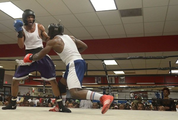 Tavon Body (Headbangers) lands a punch against Jerome Featherson (Baltimore Boxing) during a semifinals bout in the 2014 Washington Golden Gloves championship tournament at the Sugar Ray Leonard Boxing Center in Palmer Park, Md., on March 15. Body defeated Featherstone to advance to the finals.