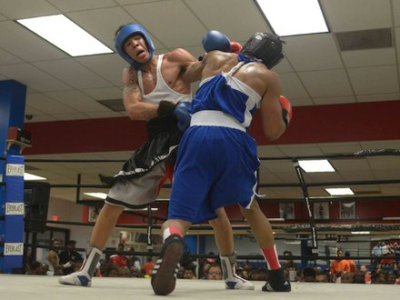 From left: Malik Hawkins (Upton Gym) gets tangled up with Drayvontay Speed-Rawls during a semifinals bout in the 2014 Washington Golden Gloves championship tournament at the Sugar Ray Leonard Boxing Center in Palmer Park, Md., on March 15. Hawkins beat Speed-Rawls to advance to the finals.
