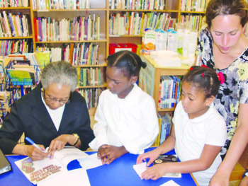Eloise Greenfield visited Shepherd Elementary School in Northeast for a book signing in May 2012 as students eagerly lined up for the author's signature. (ourtesy of Jacqueline Taiwo Ajala for DCPS)