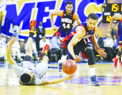 """Howard guard James """"J-Byrd"""" Daniel fights for possession of the basketball in the Mid-Eastern Athletic Conference Tournament quarterfinal game against North Carolina Central University (NCCU) on March 7 at the Norfolk Scope Arena in Norfolk, Va. NCCU defeated Howard 92-46."""