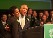 State Rep. Linda Dorcena Forry and Gov. Deval Patrick share a laugh during the annual St. Patrick's Day breakfast.