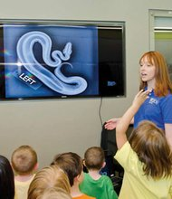 Oregon Zoo campers check out a snake X-ray during a tour of the zoo's veterinary medical center. Registration is open for the Oregon Zoo's popular Nature Rangers spring break camps (March 24-28) and summer camps (June 16-Aug. 29).