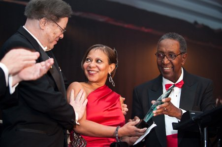 Dr. Levi Watkins (left) presents Dr Lisa Cooper (center) with the American Heart Association's Watkins-Saunders Award as Dr. Elijah Saunders (right) proudly looks on. Dr. Cooper is the principle investigator for the Center to Eliminate Cardiovascular Disparities funded by a grant from National Institutes of Health.