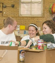Justin Walko, University of Toledo; Becca Marcott, Ferris State University; and Amy Paruk, Michigan State University are among college students from across the nation who are donating their spring break to help families facing poverty in Baltimore as part of United Way's Alternative Spring Break program.