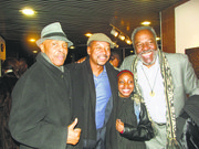 This young theater fan got a thrill as she posed with actors Roscoe Orman, Robert Townsend and Frankie Faison.