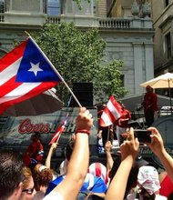 Parade-goers at a Puerto Rican Day Parade performance in NYC