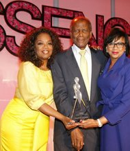 Oprah Winfrey and Sidney Poitier present the Trailblazer Award to Cheryl Boone Isaacs at the Essence Black Women in Hollywood Luncheon.