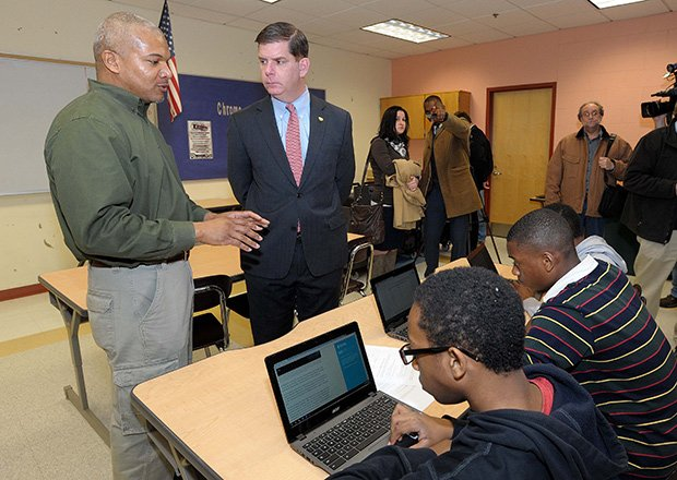 Mildred Avenue School 8th grade social studies teacher Ronaldo Shelbourne explains to Mayor Martin Walsh what his students are doing with the new Chromebooks during class time.