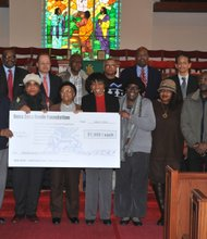 Members of the Westchester County Food Pantry Church holding a $1,000 check from the Beta Zeta Foundation (standing rear). The foundation also awarded six other Westchester food pantries with $1,000 donations.