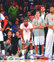 Amar'e Stoudemire (L) and teammates watching their guys losing a critical games against Cleveland, followed by a devastating lost against the Lakers in the first of a four game road trip this past Tuesday.