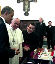 U.S. President Barack Obama and Pope Francis met for the first time at Vatican City. The two world leaders greeted each other with a smile and a handshake, and posed for pictures before sitting down across a table from each other.