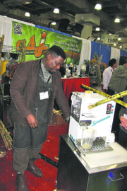 NY Restaurant Show-making sugar cane juice.