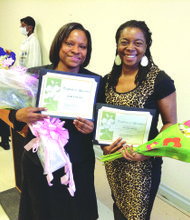 Community liaison worker Karen Smalls and Amsterdam News Editor Nayaba Arinde.