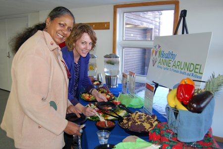 Healthy Anne Arundel Coalition representatives (left) Carlesa Finney with Anne Arundel County Public Schools and Kim Davidson of the University of Maryland Baltimore Washington Medical Center at the Coalition's Healthy Events and Meetings display table.