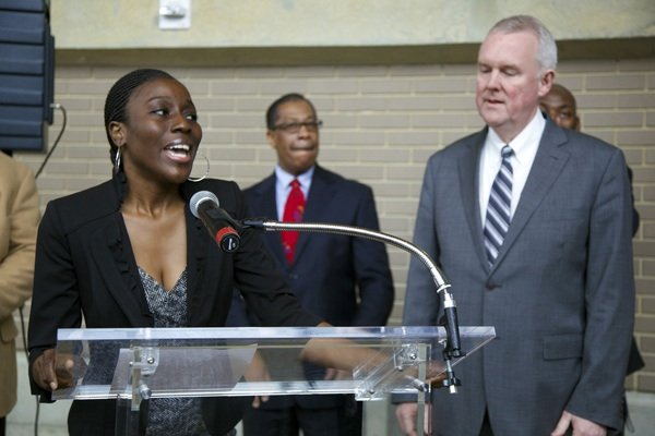 Khady Kamara, Chief Marketing Officer of Arena Stage, introduces D.C. Council Member Tommy Wells at the opening of the D.C. Job Fair on March 28 at the Mead Center for American Theater in Southwest.